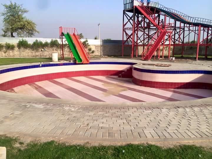 Water Slides and Swimming Pool at Shazaib Water Park, Sahiwal, Pakistan